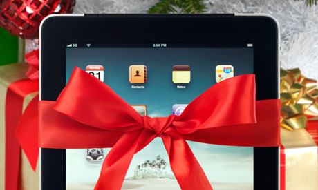 Apple iPad 3G tablet with a red gift bow tied around it